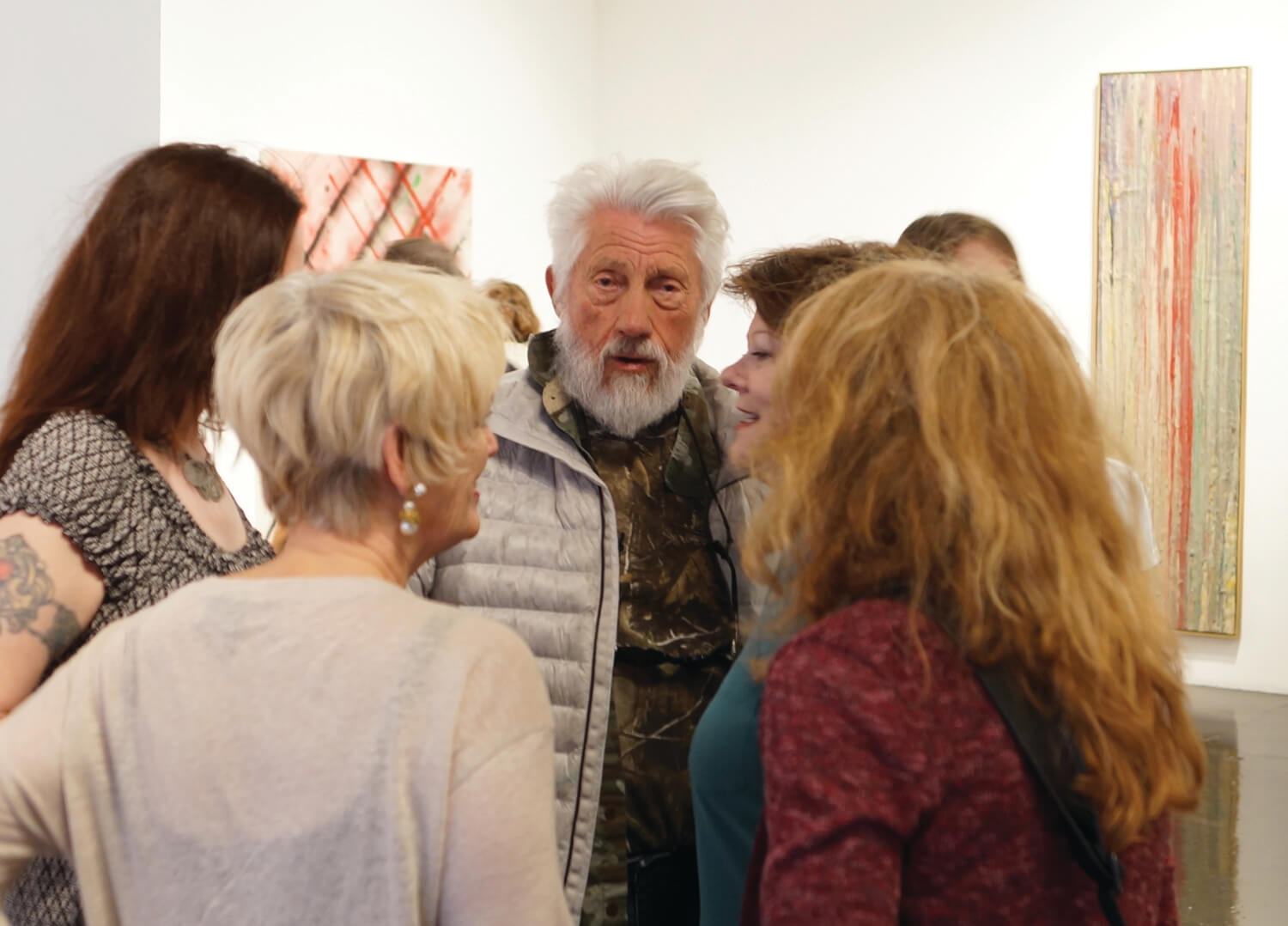 Ed Moses at his art opening at William Turner gallery, surrounded by admirers.